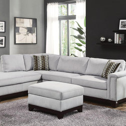Coaster Nailheads Blue Gray Velvet Sectional Sofa Reversible Chaise - Create a living room that fits your style and needs with this reversible sofa chaise wrapped in blue grey velvet. Adorned with individually placed nailheads, an exposed solid wood frame and accent pillows, our Mason sectional brings easy to match style and plenty seating. Also features a 100% solid wood full return, removable seat and fiber filled back cushions. Complete this contemporary ensemble with a matching ottoman, which can be pushed against the end of the chaise to make it extra-long.