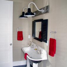 Industrial Bathroom by Barn Light Electric Company