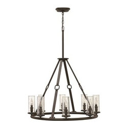 Hinkley Lighting - Hinkley Dakota Oil Rubbed Bronze Eight-Light 31.5 Wide Chandelier - The Dakota collection rounds up the best in Western style with a rustic chic design. Cast metal faux leather straps and buckle combine with clear seedy hurricane shades perched on cast cups for luxe lodge charm.Under four generations of family leadership Hinkley Lighting has transformed from a small outdoor lantern company to a global brand intent on bringing you the best in style quality and value. LIFE AGLOW: That's their mantra and they take it seriously. By welcoming their products into your home they become part of your family's everyday life illuminating small moments and big occasions. They understand your home is so much more than a physical place. It's an emotional space designed by you so they are committed to keeping your 'Life Aglow' with stylish state-of-the-art lighting. Their products are the ultimate combination of style and substance. They are constantly developing new technologies to make their fixtures even more energy efficient. Hinkley recently upgraded their LED to cutting-edge high lumen output integrated solutions and they give you hundreds of energy-efficient styles to choose from. Even their Cleveland-based world headquarters employs high energy saving standards with low VOC materials and a variety of eco-smart applications into the design to make an earth-friendly work environment for their Hinkley family. Hand crafted fixtures luxe finishes artistic details and quality materials go into the design of every product they make. They embrace the philosophy that you can merge together the lighting furniture art and accessories you love into a beautiful environment that defines your own personal style.
