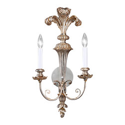 "Inviting Home - Palm Leaf Silver-Leafed Sconce - Silver-leafed wall sconce with palm leaf motif 11-1/2"" x 23-1/2""H hand-crafted in Italy The beautiful lines in the wonderful expression of carved wood sconce with elegant sophistication of antiqued silver leaf finish has a rich soft appearance. The fluted back of the sconce appearing to be bound before flaring upwards and outwards with intricately detailed palm leaf design. Carved wood sconce has elegantly scrolled arms with leaf motif candleholders. This two-light electrified sconce is designed for use with candelabra bulbs."
