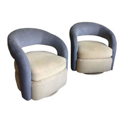 "Used Milo Baughman Style Swivel Rocker Club Chairs - With their curved backs, rounded design, and top-quality upholstery, this pair of Milo Baughman-inspired swivel rocker club chairs allows you to snuggle in, swivel 360 degrees and rock back & forth with ease. Extra wide seating surface with extra thick, high density cushions provide the ultimate in comfort. A designer from the The Merchandise Mart Design Center custom-made this chair pair. Upholstery consisting of gray microsuede and high-quality yellow iris fabric, superior workmanship, heavy-duty mechanism & tip-resistant base do not only provide durability and peace of mind but elevate this furniture to a work of art.    Dimensions: 32.0"" W x 31.0"" D x 33.0"" H  In excellent condition!"