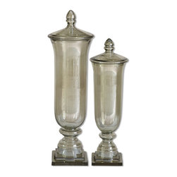 Uttermost - Gilli, Containers, Set Of 2 - Not only are these containers pretty, made from transparent pale green glass; they are also multi-functional. Use them to display colorful beads or remove the lids and use as a vase for those special cut flowers or simply display them as they are. Sizes: