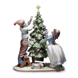 "Lladro Porcelain - Lladro Trimming The Tree Figurine - Plus One Year Accidental Breakage Replacemen - ""Hand Made In Valencia Spain - Sculpted By: Joan Coderch - Included with this sculpture is replacement insurance against accidental breakage. The replacement insurance is valid for one year from the date of purchase and covers 100% of the cost to replace this sculpture (shipping not included). However once the sculpture retires or is no longer being made, the breakage coverage ends as the piece can no longer be replaced. """