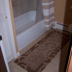 Tile in bath and tub surround -