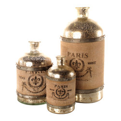 Kathy Kuo Home - French Country Paris Wrapped Burlap Mercury Glass Bottle- Set of 3 - Rustic appeal practically glows from these French Country antique glass bottles. Wrapped in burlap and featuring a fleur-de-lis design, these bottles will remind you of your last trip to Paris, when you wandered cobblestone streets, combing through treasures at market stalls. Set comes with small, medium, and large bottle.
