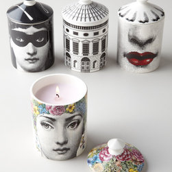 Fornasetti Scented Candle - If you love eccentric designs with an artsy touch, you might fall for these Fornasetti scented candles. The quirky ceramic containers hold scented vegetable wax that's a luxurious treat at home.