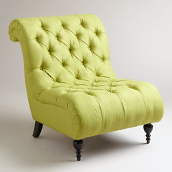 Green Tufted Devon Slipper Chair - At one end of Mary McDonald's living room is a pair of French-style chairs upholstered in green velvet. You don't have to have the exact same thing and can still get the look with a pair of these tufted beauties.