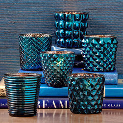 Indigo Tealight Candleholder - Set of 6 - Six geometric variations on traditional hobnail glass glow with shades of peacock and sapphire in the Set of six Indigo Tealight Candleholders. Arranged apparently at random along a rustic wooden tray or lined up on a sleek, modern mantelpiece, these candle cups in blue-tinted mercury glass have a festive transitional feel and an eclectic effect on your look.