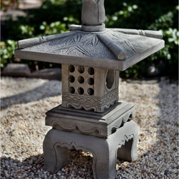 Campania International - Campania International Bamboo Pagoda Garden Statue - OR-141 - NATURAL - Shop for Statues and Sculptures from Hayneedle.com! About Campania InternationalEstablished in 1984 Campania International's reputation has been built on quality original products and service. Originally selling terra cotta planters Campania soon began to research and develop the design and manufacture of cast stone garden planters and ornaments. Campania is also an importer and wholesaler of garden products including polyethylene terra cotta glazed pottery cast iron and fiberglass planters as well as classic garden structures fountains and cast resin statuary.Campania Cast Stone: The ProcessThe creation of Campania's cast stone pieces begins and ends by hand. From the creation of an original design making of a mold pouring the cast stone application of the patina to the final packing of an order the process is both technical and artistic. As many as 30 pairs of hands are involved in the creation of each Campania piece in a labor intensive 15 step process.The process begins either with the creation of an original copyrighted design by Campania's artisans or an antique original. Antique originals will often require some restoration work which is also done in-house by expert craftsmen. Campania's mold making department will then begin a multi-step process to create a production mold which will properly replicate the detail and texture of the original piece. Depending on its size and complexity a mold can take as long as three months to complete. Campania creates in excess of 700 molds per year.After a mold is completed it is moved to the production area where a team individually hand pours the liquid cast stone mixture into the mold and employs special techniques to remove air bubbles. Campania carefully monitors the PSI of every piece. PSI (pounds per square inch) measures the strength of every piece to ensure durability. The PSI of Campania pieces is currently engineered