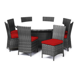 "Reef Rattan - Reef Rattan Capri 9 Piece Round Dining Set - Grey Rattan / Red Cushions - Reef Rattan Capri 9 Piece Round Dining Set - Grey Rattan / Red Cushions. This patio set is made from all-weather resin wicker and produced to fulfill your needs for high quality. The resin wicker in this patio set won't fade, shrink, lose its strength, or snap. UV resistant and water resistant, this patio set is durable and easy to maintain. A rust-free powder-coated aluminum frame provides strength to withstand years of use. Sunbrella fabrics on patio furniture lends you the sophistication of a five star hotel, right in your outdoor living space, featuring industry leading Sunbrella fabrics. Designed to reflect that ultra-chic look, and with superior resistance to the elements in a variety of climates, the series stands for comfort, class, and constancy. Recreating the poolside high end feel of an upmarket hotel for outdoor living in a residence or commercial space is easy with this patio furniture. After all, you want a set of patio furniture that's going to look great, and do so for the long-term. The canvas-like fabrics which are designed by Sunbrella utilize the latest synthetic fiber technology are engineered to resist stains and UV fading. This is patio furniture that is made to endure, along with the classic look they represent. When you're creating a comfortable and stylish outdoor room, you're looking for the best quality at a price that makes sense. Resin wicker looks like natural wicker but is made of synthetic polyethylene fiber. Resin wicker is durable & easy to maintain and resistant against the elements. UV Resistant Wicker. Welded aluminum frame is nearly in-destructible and rust free. Stain resistant sunbrella cushions are double-stitched for strength and are fully machine washable. Removable covers made with commercial grade zippers. Tables include tempered glass top. 5 year warranty on this product. Round Table: W 64"" D 64"" H 29"", Chairs (8): W 24"" D 18"" H 34"""