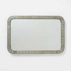 Galvani Mirror - This mirror is industrial with the beautiful patina on the zinc frame. It would look beautiful with some wood pieces, blending the cool feel of this piece with warmer tones of the wood.