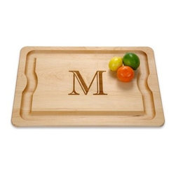 J K Adams BBQ Monogrammed Cutting Board - Large - Handcrafted by Vermont artisans from sustainably grown North American hardwood, the J K Adams BBQ Monogrammed Cutting Board – Large is a beautiful board that cuts down on BBQ mess and needless grill-to-kitchen trips. The large cutting surface features a handy meat juice moat, and the undercut handles beneath the board provide a secure grip for carrying. If we had to pick the monogrammed letter, we'd definitely give it an A for best grade in BBQ.About J.K. Adams J.K. Adams has been designing, manufacturing, and distributing wood products from Dorset, Vermont, since 1944. Their philosophy can be summed up by the three short phrases painted on large signs hanging from the factory ceiling: Quality First. Production Next. Safety Always. Judging from the company's longevity and success, this business model works. Each J.K. Adams product begins with the finest Northeastern kiln-dried lumber. By combining functionality, aesthetics, and quality manufacturing techniques, the company creates exceptional wooden products that last a lifetime.