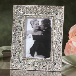 """Exposures - Windsor Frame - Overview Think of this glittering Windsor frame as jewelry for your shelf! Petite in size yet offering a glamorous visual impact, its covered in sparkling Swarovski crystals. This table frame makes an unforgettable gift for anyone who loves the radiant look of diamonds. Features White Swarovski crystals  Bronze metal base  Table frame Horizontal or vertical display Comes in a beautiful gift box   Specifications  Measures 4"""" x 5"""", holds a 2 1/2"""" x 3 1/2"""" photo"""
