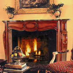 Regence Fireplace Mantel - Rolling curves and hand carved accents make the Regence Fireplace Mantel a beautiful centerpiece in any room.