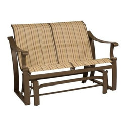 Woodard Bungalow Sling Glider - If you've been fretting over that perfect, elusive lounging spot, all you need to do is to add the Woodard Bungalow Sling Glider to your outdoor seating area. A blend of simple elegance, contemporary charm, and upscale appeal, this gliding loveseat blends effortlessly with any patio setting. Thanks to the generous seat, supportive backrest, wide armrests, and gentle gliding motion, you and a friend will sit in such luxurious comfort what you might be tempted to spend all your waking hours outdoors!Designed to withstand frequent use and the harshest elements, the sturdy, fully-welded aluminum frame comes in a choice of powder-coated finishes that will not rust, peel, or blister over the years. Great by the poolside, thanks to the quick-dry sling fabric, this glider comes in a selection of colors and patterns for a look that's stylish to the hilt. Made by Woodard, this glider is virtually maintenance-free and hoses off to clean, letting you spend all your free time out in the sun. The stylish, design, along with sturdy, enduring construction, ensures that this glider will be part of your outdoor seating area for many summers to come.Important NoticeThis item is custom-made to order, which means production begins immediately upon receipt of each order. Because of this, cancellations must be made via telephone to 1-800-351-5699 within 24 hours of order placement. Emails are not currently acceptable forms of cancellation. Thank you for your consideration in this matter.Woodard: Hand-crafted to Withstand the Test of TimeFor over 140 years, Woodard craftsmen have designed and manufactured products loyal to the timeless art of quality furniture construction. Using the age-old art of hand-forming and the latest in high-tech manufacturing, Woodard remains committed to creating products that will provide years of enjoyment.Superior Materials for Lasting DurabilityIn the Aluminum Collections, Woodard's trademark for excellence begins with a core of seamless, virgin aluminum: the heaviest, purest, and strongest available. The wall thickness of Woodard frames surpasses the industry's most rigid standards. Cast aluminum furniture is constructed using only the highest grade aluminum ingots, which are the purest and most resilient aluminum alloys available. These alloys strengthen the furniture and simultaneously render it malleable. The end result is a fusion of durability and beauty that places Woodard Aluminum furniture in a league of its own.All Seasons Outdoor Wicker is the latest addition to the Woodard line of quality furniture. Each piece is constructed using cutting-edge synthetic fibers, hand-woven over an aluminum frame. With this combination of resilient, weather-resistant materials and Woodard's quality workmanship, All Seasons Wicker will retain its beauty and integrity for years.Fabric, Finish, and Strap Features All fabric, finish, and straps are manufactured and applied with the legendary Woodard standard of excellence. Each collection offers a variety of frame finishes that seal in quality while providing color choices to suit any taste. Current finishing processes are monitored for thickness, adhesion, color match, gloss, rust-resistance and, and proper curing. Fabrics go through extensive testing for durability and application, as well as proper pattern, weave, and wear.Together, these elements set Woodard furniture apart from all others. When you purchase Woodard, you purchase a history of quality and excellence, and furniture that will last well into the future.