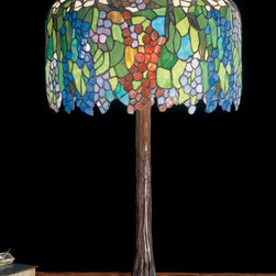 Meyda Tiffany - Meyda Tiffany Grapevine Tiffany Table Lamp X-66894 - The hanging grapevine detailing of this Meyda Tiffany table lamp is accentuated by bold and vivid shades of green, blue, red, orange and more. The unique detailing of this transitional table lamp, which features an eye-catching trunk-like base, has been complimented by a coordinating bronze-toned finish whose warm tones pull the look together.