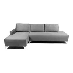 Lazar Easton Upholstered Sectional Sofa - The contemporary look of the Lazar Easton Upholstered Sectional Sofa might bring to mind sharply hewn granite, but you'll find it as soft as silk. Interlocking plywood (in a puzzle-notched fashion) makes up the frame of this piece, while the overlong foam cushions are upholstered in 100% polyester. The set includes a chaise and a sofa pieces. No assembly is required. A lifetime warranty guarantees the frame and seating deck; three year warranty on the foam cushions.Delivery Notice: This item includes White Glove Delivery. This means your item ships via cushioned trucking and is delivered to the room of your choice, including up to two flights of stairs. The product is unpacked and debris is removed. Basic set-up without tools is included. We're proud to offer this service so that you can rest assured your item will arrive in excellent condition and be placed with care in your home.About Lazar IndustriesFounded in 1983, Lazar Industries is a privately held corporation specializing in high-quality, custom-made upholstery. With a reliable workforce of highly skilled craftspeople, Lazar has become one of the premier upholstered furniture resources in the industry. Lazar's fashionable and comfortable seating products are made in the USA in two manufacturing facilities, one in southern California, and one in North Carolina.