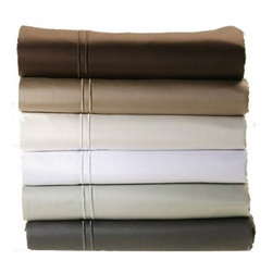 "600 Egyptian Cotton Sateen Sheet Sets - 600TC 100% Pure Egyptian Cotton Sheet Sets. Fully elasticized fitted sheet fits mattress depths from 6"" to 22"". Flat sheets are sized to extend 20"" on the mattress sides and 26"" at the foot of the bed. Pillowcases are cut two inches longer and two inches wider. Flat sheet and pillowcases feature a luxurious satin stitch hem."