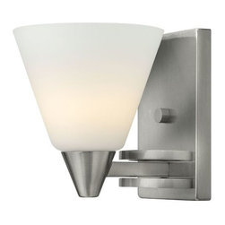 Hinkley Lighting - Dillion Wall Sconce by Hinkley Lighting - All on its own, the Hinkley Lighting Dillon Wall Sconce is a cooly contemporary way to illuminate a space. It also coordinates with the rest of the Dillon collection, with a petite cone of Etched Opal glass and a substantial looking steel base in a Brushed Nickel finish. Cleveland-based Hinkley Lighting is driven by a passion to combine design and function to create exceptional lighting solutions. Family-owned Hinkley began as a traditional lantern company in 1922, and, still today, they produce top quality outdoor lighting. Hinkley Lighting has also expanded to include a full range of interior lighting solutions, including chandeliers, sconces, pendants and vanity lights.