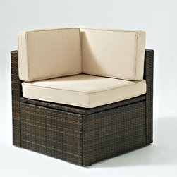 Crosley - Palm Harbor Corner Chair - This all-weather chair provides the perfect seating option for any outdoor oasis. Boasting an attractive woven design over a durable frame and resistance to UV rays and fading, it's sure to provide comfort and style wherever it's arranged for many seasons to come.   26.75'' W x 25.5'' H x 26.75'' D Resin wicker / steel / fabric Assembly required Imported