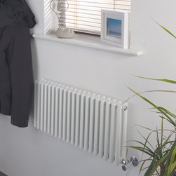 Hudson Reed - Luxury White Designer Radiator Heater 12 x 30 & Fixings & Valves - With a heat output of 512 Watts (1,748 BTUs), this designer towel radiator, in a fashionable white powder coat finish (RAL9016), is stylish and highly efficient, ensuring that your towels are warm and your room is heated.  This luxury radiator is designed especially for use in any any room of the house, looking equally stylish in a modern or traditional setting; its twenty white vertical double columns bring a touch of elegance to any living space. This modern version of the traditional cast-iron radiator is also highly functional, connecting directly into your domestic central heating system via the radiator valves included Luxury White Horizontal Designer Radiator 12 x 30 Details  • Dimensions: (H x W x D) 12 (300mm) x 30 (760mm) x 3.15 (80m) • Output: 512 Watts (1,748 BTUs)• Pipe centres with valves: 10.4 (265m) • Wall to Tapping centre: 1.75 (45mm)• Number of columns: 2 x 20 - 1 (25mm) thickness• Fixing Pack Included (see image above) • Designed to be plumbed into your central heating system • Suitable for bathroom, cloakroom, kitchen etc.ng space, at an affordable price. • Please note: angled radiator valves included Buy now, to transform your bathroom or other living space, at an affordable price.  5 year warranty Please Note: Our radiators are designed for forced circulation closed loop systems only. They are not compatible with open loop, gravity hot water or steam systems.