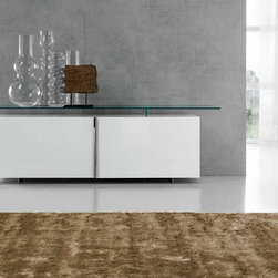 Avenue Lacquered Sideboard By Cattelan Italia - Sideboard with 2 sliding doors. Structure in shiny white or black lacquered wood. Top and details in clear glass extra light glass or fume glass. Clear glass inside shelves. Explore the plain simplicity and utility of the Avenue Wooden Sideboard with a professional look.