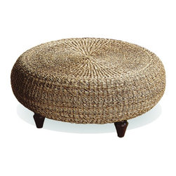 Urban Home Natural Banana Core Ottoman - Nix a traditional coffee table with sharp corners in favor of a round ottoman that can serve as both table and footstool. I love the texture this woven ottoman adds to the room.