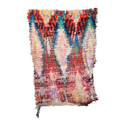 Used Multi-Color Diamond Print Boucherouite Rag Rug - This Boucherouite rag rug features a typical design in a range of diamond, symmetrical patterns and free form abstracts.  A one of a kind piece. Most vintage pieces date from the 1960s-1980s. Can be used as rugs or wall hangings. This piece was hand selected from the souks in Morocco.  Handmade of 100% Wool.  Border on one end only. Handmade in Morocco of Recycled fabrics--clothing, bed sheets, blankets, whatever was available.