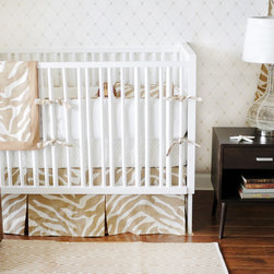 New Arrivals - New Arrivals Crib Bedding Safari Sand - Reflecting the whimsy and joy of life, New Arrivals delivers fun and function to a child's room. A spirited nursery design, the sand brown and cream Safari crib bedding delivers a playful combination including a zebra print, polka dots and solid fabric. This wild animal-inspired sheet, skirt, receiving blanket and bumper collection offers sets of two, three or four coordinating pieces. Optional boudoir pillow, changing pad cover and two curtain panels are available. Handmade in the USA.
