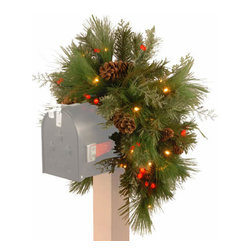 36 In. Pine Christmas Mailbox Swag Garland w/ 63 White & Red LEDs - Measures 36 inch height. Features mixed branch tips with red berries and pine cones. Pre-lit with 63 UL listed, Warm White and Red LED lights. Tip count: 117. Indoor or covered outdoor use. Battery operated with 6 hours ON/18 hours OFF timer. LED lights are energy-efficient and long lasting. Fire-resistant and non-allergenic.
