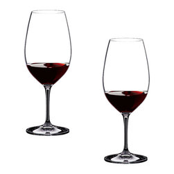 Riedel - Riedel Vinum Syrah/Shiraz Glasses - Set of 2 - This shape was developed between 1993 and 1995 following tastings in the major Syrah growing regions, when most influential winemakers contributed their views on how the message of their wines should be put across. The wines made from the Australian grape variety Shiraz, give a deep purple, almost inky color. The nose resembles intense, rich blackberry aromas. The flavors on the palate show mouthfilling fruit, massive structure and a long sweet finish. The Syrah glass highlights the tannins, offering a perfect balance with the overwhelmingly concentrated fruit. Recommended for: Amarone, Barbera, Blaufr�nkisch, Cahors, Cannonau, Carignan, Carmenère, Ch�teauneuf-du-Pape, Cornas, C�te R�tie, C�tes du Rh�ne Rouge, C�tes du Roussillon, C�tes du Ventoux, Crozes Hermitage, Grenache/Garnacha, Hermitage (red), Madiran, Malbec, Mourvèdre, Norton, Petite Sirah, Pinotage, Priorato, Shiraz, St. Joseph (red), Syrah, Tannat, Touriga Nacional, Zweigelt