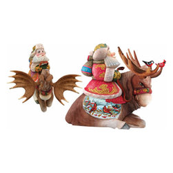 """Artistic Wood Carved Santa Claus on Majestic Winter Moose Sculpture - Measures 10""""H x 10""""L x 4""""W and weighs 5 lbs. G. DeBrekht fine art traditional, vintage style sculpted figures are delightful and imaginative. Each figurine is artistically hand painted with detailed scenes including classic Christmas art, winter wonderlands and the true meaning of Christmas, nativity art. In the spirit of giving G. DeBrekht holiday decor makes beautiful collectible Christmas and holiday gifts to share with loved ones. Every G. DeBrekht holiday decoration is an original work of art sure to be cherished as a family tradition and treasured by future generations. Some items may have slight variations of the decoration on the decor due to the hand painted nature of the product. Decorating your home for Christmas is a special time for families. With G. DeBrekht holiday home decor and decorations you can choose your style and create a true holiday gallery of art for your family to enjoy. All Masterpiece and Signature Masterpiece woodcarvings are individually hand numbered. The old world classic art details on the freehand painted sculptures include animals, nature, winter scenes, Santa Claus, nativity and more inspired by an old Russian art technique using painting mediums of watercolor, acrylic and oil combinations in the G. Debrekht unique painting style. Linden wood, which is light in color is used to carve these masterpieces. The wood varies slightly in color."""