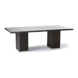 """Frontgate - Metropolitan Glass-overlay Outdoor Dining Table in Panther Finish, Patio Furnitu - Contemporary design. Handwoven high-quality fibers. Polished 304 stainless steel accents. Hidden powdercoated aluminum frames. Table with tempered glass overlay. The cool, contemporary look of our Metropolitan Panther Dining Collection is an enduring choice for dining outdoors. The table and chairs are handwoven from dark panther high-quality fibers that resist fading, staining, and splintering. Highly polished 304 stainless steel on the table base and chair legs provides a sleek contrast. Part of the Metropolitan Panther Collection.  .  .  .  .  . Cushions included with chairs . Table feature a 2"""" umbrella hole. Brisa Polar fabric is marine-grade, synthetic leather ."""