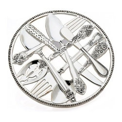 """Godinger Silver - Flatware Designed Trivet - You don't need to damage your table and linens when serving hot from the oven dishes when you place this trivet beneath the serving dish. When not in use, the trivet makes an elegant display in your kitchen. Preserve your furniture with this original silver-plated flatware design trivet. Great for tea and coffee pots, or any other hot apparatus. Diameter is 9""""."""