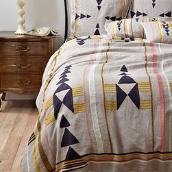Isleta Duvet Cover - This bedding is perfect for a desert retreat. I love the neutral linen paired with soft peaches and mustard yellow.