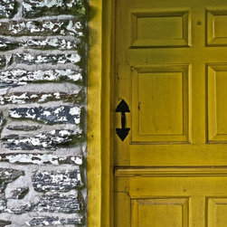 """Bright Yellow Door "" Artwork - A bright yellow door is set into a rustic stone wall."