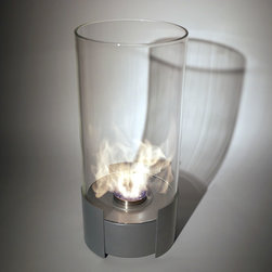 """Bluworld - Nu-Flame Tabletop Caldo Ethanol Fireplace - This is certain to be your favorite center piece. Standing over 20"""" tall this impressive portable tabletop fireplace features a brushed stainless steel base and stunning tempered glass cylinder encasing the flames. Caldo tabletop bio-fireplace is easily moved from room to room when not in use and may be used indoors or out, however do not leave your fireplace outside exposed to the elements after use. Ships with snuffer.  Fuel not included, we recommend using Nu-Flame Bio-Ethanol Fuel."""