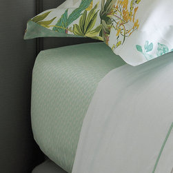 Frontgate - Yves Delorme Ailleurs Fitted Sheet - Woven with spring floral prints and finished in bright colors of a blossoming flowerbed, the Yves Delorme Ailleurs Fitted Sheet will create a botanical-inspired oasis in your bedroom. Made of premium Egyptian cotton, a white and aqua geometric pattern coordinates with the lively tropical print atop a crisp white background.Yves Delorme has been a family-owned purveyor of fine linens since 1845. Made of 100% premium Egyptian cotton . 300 thread count . Machine wash at a maximum of 140 degrees Fahrenheit. Tumble dry low; see product label for further instructions . Made in France.