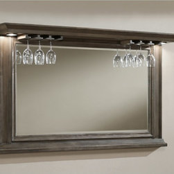 American Heritage Billiards - AHB Riviera Back Bar Mirror - 100842WO - Shop for Mirrors from Hayneedle.com! Your home bar becomes as stately (and maybe as storied) as any fine libations establishment with the addition of the AHB Riviera Back Bar Mirror. Crafted with solid oak and oak veneer in several elegant finishes you choose your favorite this large mirror is ideally appointed for the home bar. Two integrated accent lights at each top corner set an upscale mood while a built-in stemware rack across the top gives you a place to artfully store and display wine glasses. Beveled-edge glass is clear and space-opening and subtle molding and trim make this piece perfect for traditional transitional and modern-country interiors alike.American Heritage BilliardsBefore founding American Heritage Billiards back in 1987 the owners were building pool tables in high school learning the industry from the ground up. Today their 170 000 sq.-ft.-facility centrally located in Cleveland Ohio is the largest billiards manufacturer in the world the leader in design selection service and value.Each item of entertainment furniture is meticulously designed and engineered to withstand the test of time utilizing old-fashioned wood joinery methods. The vast majority of our metal products have welded joints to provide a lifetime of carefree service.