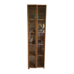 Pre-owned Custom-Made Teak & Glass Cabinet - This is a beautiful, teak display cabinet custom made in Kuala Lumpur. It is extremely well made and provides quite a bit of storage and display space. The natural teak wood is smooth and fits in several decor settings. There is a small issue with the wooden pedestal which is easily resolved and does not detract from the utility at all.