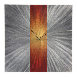 None - Orange Stripe Modern Metal Wall Clock - The Orange Stripe Clock is a modern metal wall clock with a very unique twist. It features a metallic silver body with a creative starburst pattern in the background.