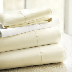 Ballard Designs - Set of 2 Ballard Signature Sateen Pillowcases - Ivory King - Our Signature Sateen Sheets are the perfect foundation for the well-made bed. Because sateen is woven with more top threads, it has a subtle sheen and provides cozy warmth on cool nights. The perfect blend of softness, silkiness and strength, our Signature Sateen Sheets are made of luxurious 400-thread count cotton, specially selected for its exceptionally supple hand.Ballard Signature Sateen Pillowcase features:Silky, soft sheen finish with tailored single-fold border. Layers with our best-selling Signature Sateen Sheets. Customize with a monogram.