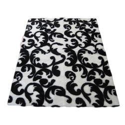 Walk on Me - Contemporary Black and White Flourish Rug - Dramatic color scheme adds elegance and whimsy to this lovely piece - thick, soft, unusual - jet black, soft natural white - machine washable, hypoallergenic, non-slip - short pile - Made in France
