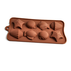 UNIVERSAL - Ocean Theme Silicone Mold Baking Pans - Bake treats in the shape of fish, shells and starfish with this silicone pan mold. This pan is versatile and can be used for making cakes, ice cubes and chocolates, all mess-free thanks to a nonstick, flexible surface.