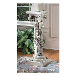 Design Toscano - Design Toscano The Rose Garland Sculptural Pedestal - EU2866 - Shop for Caddies and Stands from Hayneedle.com! About Design Toscano:Design Toscano is the country's premier source for statues and other historical and antique replicas which are available through the company's catalog and website. Design Toscano's founders Michael and Marilyn Stopka created Design Toscano in 1990. While on a trip to Paris the Stopkas first saw the marvelous carvings of gargoyles and water spouts at the Notre Dame Cathedral. Inspired by the beauty and mystery of these pieces they decided to introduce the world of medieval gargoyles to America in 1993. On a later trip to Albi France the Stopkas had the pleasure of being exposed to the world of Jacquard tapestries that they added quickly to the growing catalog. Since then the company's product line has grown to include Egyptian Medieval and other period pieces that are now among the current favorites of Design Toscano customers along with an extensive collection of garden fountains statuary authentic canvas replicas of oil painting masterpieces and other antique art reproductions. At Design Toscano attention to detail is important. Travel directly to the source for all historical replicas ensures brilliant design.