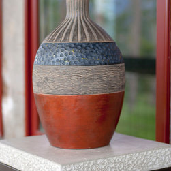 Rare Finds Collection - This beautiful ceramic vase is hand made of natural clay and hand finished with a rich copper and black patina. A shorter, wider version of the same design is available, along with a set of vases finished in green and gray.