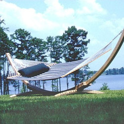 Hampton Cypress Arc Hammock Stand-4 Ply - With its attractive curves and graceful design this undeniably appealing hammock stand will be the centerpiece of your backyard! Its natural classic beauty shines through its four layers of laminated Southern Cypress. Accommodates large or deluxe sized spreader hammocks 12 to 15 feet in overall length. Heavy and solid it can hold two average size adults plus two kids and then some.Over time the sun will naturally turn the Hampton Cypress Arc Hammock Stand a silvery gray. Another beneficial quality of cypress wood is its natural oils that help it resist damage from moisture. A coat of linseed oil every year will provide additional protection to keep the stand in optimum condition. The Hampton Cypress Arc Hammock Stand will weather best if positioned in direct sunlight. Shaded areas encourage moisture retention and will lead to the deterioration of the hammock stand as the wood softens.Please note: This hammock stand works with spreader bar hammocks only. Add a sleek design element to enhance your yard and hang your hammock. Order the Hampton Cypress Arc Hammock Stand today!