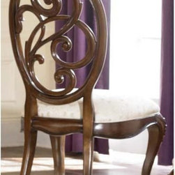 "American Drew - American Drew Jessica McClintock Couture Splat Back Dining Side Chairs - Set of - Shop for Dining Chairs from Hayneedle.com! Crafted with a classic style the American Drew Jessica McClintock Couture Splat Back Dining Side Chairs adds a traditional feel to any dining setting. This beautiful set of two chairs are made with hardwood solids and given Mink Brown finish. The soft padded seat is adorned with patterned light tan upholstery. Floral-inspired scrolling on the splat back complement the detailed curved legs. Create a refined setting with this elegant set of fine dining chairs.About American DrewFounded in 1927 American Drew is a well-established leading manufacturer of medium- to upper-medium-priced bedroom dining room and occasional furniture. American Drew's product collections cover a broad variety of style categories including traditional transitional and contemporary. Their collections range from the legendary 18th-century traditional ""Cherry Grove "" celebrating its 42nd year of success to the extremely popular ""Bob Mackie Home Collection "" influenced by the world-renowned fashion designer Bob Mackie. ""Jessica McClintock Home"" features another beloved designer bringing unique style to an American Drew line. American Drew's headquarters are located in Greensboro N.C. Their products are distributed through thousands of independently owned retailers throughout the United States and Canada and around the world."