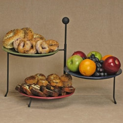 J & J Wire 9-in. Triple Serving Rack - Company is on its way and there's no better way to showcase your delectable dishes than on the elegant J & J Wire 9-in. Triple Serving Rack. Adjust the three tiers to accommodate your famous holiday recipes for serving on a countertop buffet or right on the dining table. Proudly made in the USA from wrought iron with a black powder-coat finish this clever serving rack can stand the heat of dishes straight from the oven. It even folds up for convenient storage until the next family feast.About J & J Wire Inc.Located at the Industrial Park in Beatrice Nebraska J & J Wire Inc. started 25 years ago as a wire-forming business manufacturing mostly houseware items. Since then the company has grown into a metal fabrication business serving customers in many different manufacturing sectors in the United States and Canada. From quilt racks to wine racks J & J Wire is committed to creating handmade works of art at affordable prices.