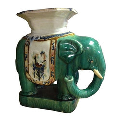 "Pre-owned Green Ceramic Plant Stand Elephant - Vintage ceramic plant stand hand painted elephant made in China. Some chips on bottom edge. 22"" x 11"" x 22""h. This a great authentic looking piece. You can see where some paint has run during the making process which adds to the look and feel of this piece. How good would this look in the corner of a room with some exotic plant on top."